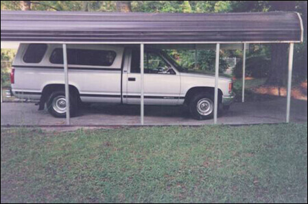 Mario's gray 1987 Chevy pickup truck parked on a covered driveway outside his home.