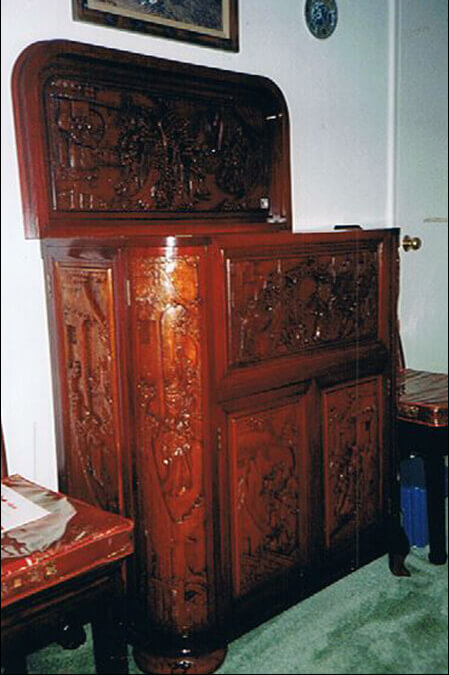 A hand-carved, solid rosewood bar with ornate etchings, also imported from China as part of Mario's dining room set.