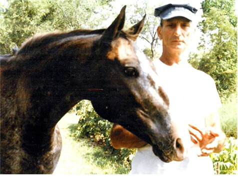 Mario Masiello stands beside his horse.